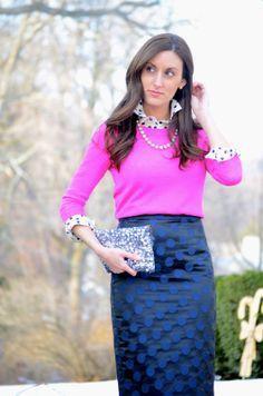 pink sweater over polka dot blouse, navy pencil skirt