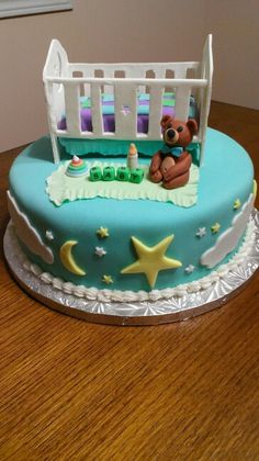 Crib baby shower cake with moon and stars theme
