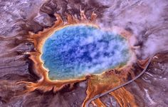 Grand Prismatic Spring, Yellowstone National Park  ..........................  the largest hot spring in the United States, and the third largest in the world, next to those in New Zealand. It is located in the Midway Geyser Basin. The spring is approx. 250 by 300 feet in size and is 160 feet deep. The spring discharges an estimated 560 US gallons of 160 °F (70 °C) water per minute.