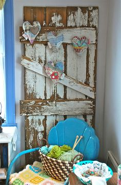 old door as wall decoration / pinboard    Would look good in my craft room for displaying crafts I make.