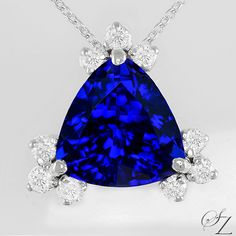 A pretty pendant that has its own beauty to make it stand out on its own. A fine, vivid blue Tanzanite trillion bursting with wonderful bright shards of shimmering blue that dance across the stone, set with sparkling white Diamond brilliants on each corner.