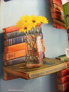 A simple book shelf...literally!  I'm wondering if good books were damaged in the process?  Otherwise, it is creatively and visually pleasing.