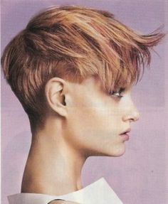 This Choppy Pixie Haircut is Tapered Very Short at the Neckline and around the ears.  The interior of the hair gradually gets longer as you up to the top and front. Apply Volumizing serum to damp hair, then blow-dry hair from the crown forward with a vent brush.  Slightly flip the front just as a little as you blow-dry.  Wax individual strands.