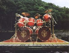 "Neil Peart of Rush, playing Tama ""Artstar"" (prototype) on the swimming-raft of Le Studio during ""Signals"" recording session, 1982."