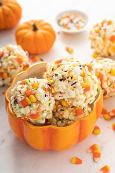 Halloween Popcorn Balls combine mini candy corn and seasonal sprinkles with the traditional popcorn to make a fun treat that is perfect for spooky season!