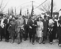 Martin Luther King, Jr. & his wife Coretta Scott King lead a black voting rights march in Selma, Al Photo at Art.com
