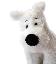 I fell in love with Tintin's faithful dog Snowy -- he was called Milou in the original Belgian comic books -- one long winter afternoon visiting...