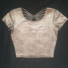 Forever 21 crop top with back detail Copperish gold crop top with back detail. Forever 21. Size small. Worn only once, in good condition! Forever 21 Tops Crop Tops