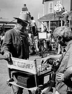 "John Wayne and photographer, David Sutton, playing chess on the set of ""Chisum,"" Warner Bros. Old Hollywood Stars, Old Hollywood Movies, Hollywood Actor, Vintage Hollywood, Wild West, Iowa, John Wayne Movies, Kings Game, Actor John"