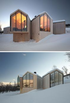19 Examples Of Modern Scandinavian House Designs | Multiple wood clad structures feature black framed windows that look out at different angles to create a unique design, a dramatic contrast, and offer a variety of views.