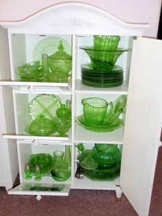 Vintage green depression glass.  doesn't that look gorgeous in the white cabinet! ❤~