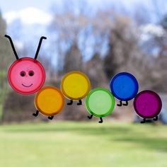 If you are anticipating spring's warm sun and blue skies, then this colorful caterpillar suncatcher craft is perfect for you! Made from recycled Play-Doh lids, this easy spring craft is fun for kids of all ages.