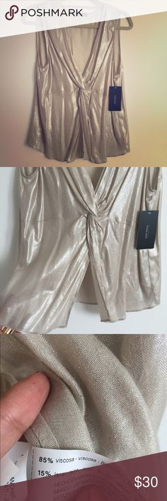 Zara metallic blouse NWT Beautiful Zara top with crossover front in a shimmery gold lightweight viscose and wool blend. Great for an evening out on a beach vacation! Zara Tops Blouses