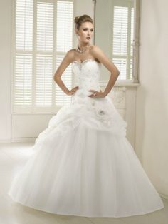 The Suffolk Wedding Dress Exchange is a Bridal Barn in Framlingham, Suffolk selling sample and once worn designer weddding dresses at discounted prices. Ronald Joyce, Petra, Ruffles, Size 12, Bridal, Wedding Dresses, Bride Dresses, Bridal Wedding Dresses, Ruffle Beading
