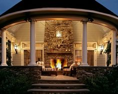 Wow. Beautiful covered porch with an outdoor fireplace