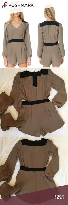 long sleeve colorblock cutout romper in taupe Stylish and chic color block romper in taupe and black by Donna Mizani. Black banded waist and black color blocking at shoulders with a zip closure. Long sleeves are banded with elastic for extra flowy fit. V-neck. Perfect for a night out with booties! Excellent used condition. No flaws. donna mizani Dresses