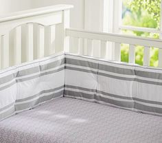 Mini Medallion Crib Sheeting gray with touches of pink will be beautiful in the Bratt Pewter Crib.