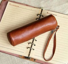 The tubular shape, beautiful leather and smart wrist strap make this writing utensil case a step above many others.