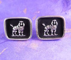 These Huge vintage French POODLE Cufflinks are crafted in silvertone metal with a black enamel background. Perfect cufflink set for the show dog performer during competition.This is the Time to be thinking of the upcoming holidays and what better way then that something for the men that have everything! This would be a great idea because it is Vintage and not something you can buy Everyday. OR perhaps Just A perfect addition to a collection.Boxed for gift giving; gift wrapped on request.?…