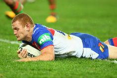 Alex McKinnon of the Knights dives over to score a try during the round 12 NRL match between the South Sydney Rabbitohs and the Newcastle Knights at ANZ Stadium on June 1, 2013 in Sydney, Australia.