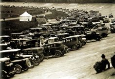 Cars parked on the banking at Brooklands race track - UK - 4 June 1930. These cars would definitely not qualify for a #logbookloan...as lovely as I'm sure they are. Just a *bit* too old!