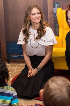 Swedish Princess Madeleine was happy to kneel on the floor as she met a group of children