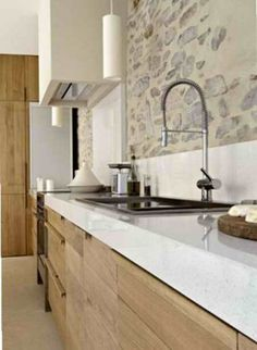 Modern Rustic Kitchen Design, love the exposed rough stone on the backsplash