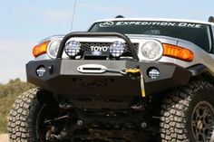 "The Expedition One Trail Series front bumper for the FJ Cruiser. Comprised of a 3/16"" inner structure, and 1/8"" thick outer skin to keep strength maximized while keeping the overall bumper weight at an astonishing low of just over 100lbs. As always, standard features include integrated winch mount, 1"" thick 3/4 recover shackle mounts, center hoop, and textured black powder coat. $1028.99"