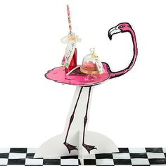 Our Alice Tea Party Treat Stands are the perfect centerpiece for your Mad Hatter Tea Party or an Alice in Wonderland Party.  This trio features your favorite ch
