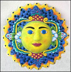 """Hand Painted Metal Sun Wall Decor - Metal Wall Decor - Haitian Art - 17"""" x 17""""  Hand painted decorative Haitian sun design for your home or patio decor. This metal sun wall hanging has been hand cut from a flattened, recycled 55 gallon steel drum and beautifully hand painted. An eco-friendly art piece."""