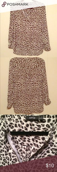 Apt. 9 Dress Shirt White and black leopard print. Zipper neck closure. Makes a great outfit for work or play when paired with black dress pants. Apt. 9 Tops Blouses