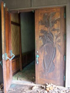 ruins of Coco Palms resort hotel Kauai, palm detail, carved wood doors