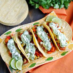 Roasted Veggie Tacos with Avocado Cream recipe. A variety of roasted vegetables topped with avocado cream (made with Greek yogurt) and crumbled goat cheese.