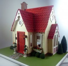 Buttercup cottage dollhouse.  .....Rick Maccione-Dollhouse Builder www.dollhousemansions.com