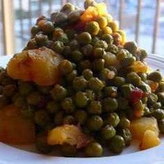 Peas are normally considered a side dish, but in Greece it is common to eat a plate full of vegetables as a main course. This traditional way of cooking peas is so satisfying and healthy. Serve with crusty bread and feta for the ultimate meal. Vegetable Sides, Vegetable Recipes, Vegetarian Recipes, Cooking Recipes, Healthy Recipes, Cooking Ribs, Cooking Bacon, Cooking Games, Dill Recipes