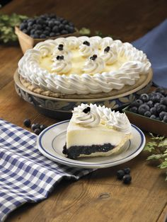 Double Cream Blueberry Pie: Creamy vanilla custard and sour cream top a bed of savory blueberries, enhanced with flavorful apples.