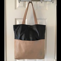 Cole Haan Black Leather Large Tote Bag Snap closure.  4 interior pockets (1 zips).  Leather. Measures: 11.5x4x13.5x9.5.  Bag is worn on corners and is dirty. Cole Haan Bags Totes