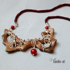 Unusual wire wrapped wooden pendant with coral beads by Yannikoart