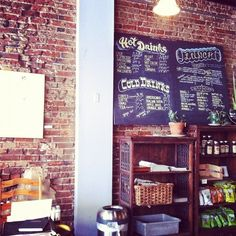 love the exposed brick and blackboard