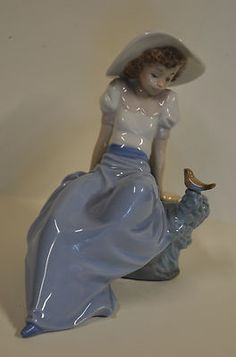 Lladro Porcelain Figurines For Sale » Lladro NAO Porcelain Figure of a Girl with a Bird