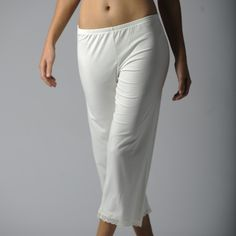 """These sweet capri length pants will be slip on you reach for when curling up in fireside. You'll fall in love with the stretch fit, comfort waistband and lace trim at the hems. The ecolux lace grouping is part of Jonäno's new """"Maïsse"""" Collection of fabric blends that incorporate corn-based elements with viscose from bamboo and a hint of spandex for an innovative eco-chic twist. Even though the Ecolux Lace PJ Capri Pant is designed for sleeping, you'll want to spend every evening around the…"""
