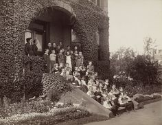 About 38 small children and 8 teachers pose for a group portrait on the steps of the Kindergarten Department of the Perkins Institution for the Blind in Jamaica Plain, Massachusetts, circa 1893. Visit the Perkins Archives Flicker page: http://www.flickr.com/photos/perkinsarchive/collections/