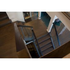 Petros Homes. Modern Contemporary Home. Glass wall open dual staircase.