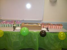Cake table setup.. pretty basic but with popcorn boxes ( used for party Favors) to tie in circus theme and the colors for the Jungle it turn out cute.