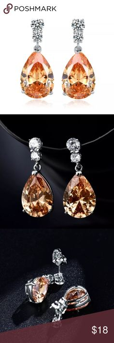 Champagne Sapphire CZ & White Gold Filled Earrings Champagne Sapphire cubic zirconia and 18K white gold filled earrings. Please see photo #5 for information on gold filled vs. gold plated. GULICX Jewelry Earrings