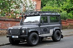 Land Rover Defender:  Like the lights, roof rack, Land Rover badge, headlight protectors, wheels, snorkel, mud flaps, colour.