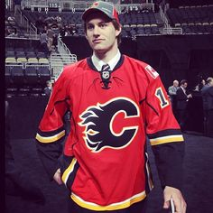 Jon Gillies, goaltender for the Indian Ice, leaves the stage as a member of the Calgary Flames after being drafted  in the 3rd round as the 75th overall selection.