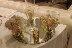 Mirror with Gold Bud vases, gold tea light holders and a flute vase