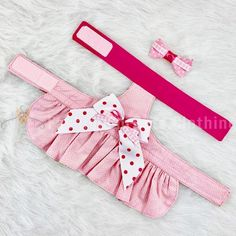 This fully lined pink and white polka-dot sun dog dress is lightweight and the perfect compliment to a summer day bbq. This dog sun dress comes with a matching hair bow. *Different fabric choices are available.  Comes with a matching hair bow  Ask us about a matching visor hat  DOG DRESS DETAILS •