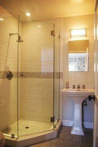 Corner shower. Frameless glass shower door.